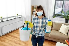health and hygiene concept - smiling asian woman wearing protective medical mask for protection from virus holding bucket of cleaning stuff and detergent at home - Buy this stock photo and explore similar images at Adobe Stock Selling Real Estate, Real Estate Tips, Department Of Veterans Affairs, Toilet Cleaning, House Prices, Home Buying, Clean House, Asian Woman, Rugs On Carpet