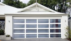 Our Ultimate Sectional Garage Doors are all about flaunting absolute street appeal. Create a custom design to suit your taste and budget. Centurion's Ultimate Range doors are each distinctive in their own right. Custom Garage Doors, Garage Door Design, Custom Garages, Sectional Garage Doors, Laser Cut Panels, Building Ideas, Design Your Own, Custom Design