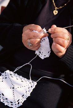 Elderly Woman Crocheting in Portugal
