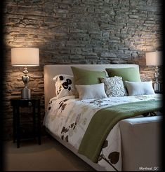 Stone feature wall - placed behind the bed and illuminated nicely to draw more attention to it.