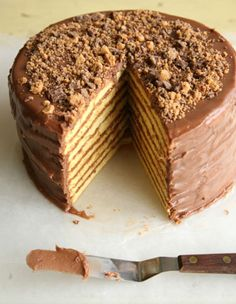 Smith Island Cake from Smith Island, Maryland. This version of the Smith Island cake comes from island resident Mary Ada Marshall. Each layer contains a sprinkling of powdered peanut butter cups, and the top is garnished with chunks of the same. Köstliche Desserts, Delicious Desserts, Dessert Recipes, Baking Recipes, Easy Recipes, Sweets Recipe, Cupcakes, Cupcake Cakes, Smith Island Cake
