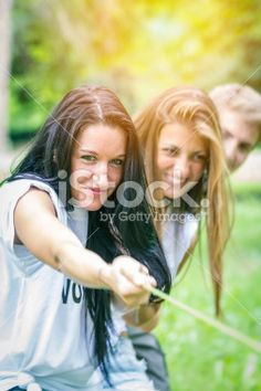 Friends playing Tug of war #cooperation #teamwork #young #friendship #sport #playing #community #work #outdoor #microstock