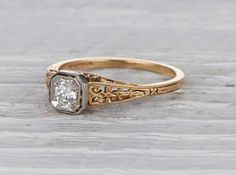 Edwardian vintage engagement ring made in 18k yellow gold and platinum. Centered with an approximately .25 carat old European cut diamond. Signed Tiffany & Co. Circa 1915 Delicate and detailed hand ca