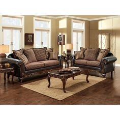 Introduce a refreshing, traditional-inspired design into your home with the two-piece sofa and loveseat set. This set offers a fabric and leatherette upholstery migration with elegant diamond pattern cushions, and artful wood floral trimmings.