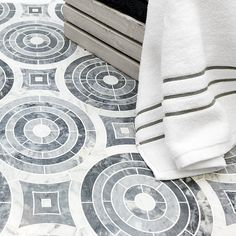 """Classic Carrara and Bardiglio marble crafted with waterjet precision. Shop this tile pattern and more at TileBar.com. Krista Watterworth """"Spin"""" tile pictured above."""