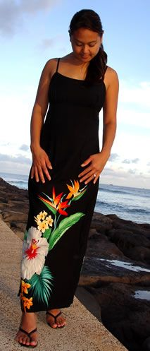 A beautiful Hawaiian dress for luaus or elegant events. Darted all around for slim fit. Seamless back/front landscape pattern with skinny adjustable straps, empire waist and easy back zipper. Ankle length with left side split-opening. The Hawaiian Tropic design shows off the beautiful flowers of our beautiful islands: Hibiscus – the state flower, Bird of Paradise, and fragrant yellow Plumerias on a soft black rayon background.