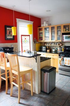 I like this kitchen too, not as much as the green one I pinned earlier, but I like the bold wall and the breakfast bar