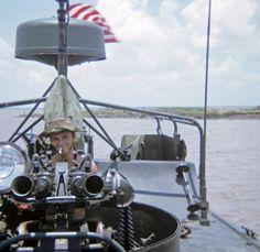 Manning the guns of a Navy patrol boat (PBR).
