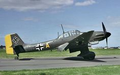 """The Junkers Ju 87 or Stuka (from Sturzkampfflugzeug, """"dive bomber"""") was a two-man (pilot and rear gunner) German dive bomber and ground-attack aircraft. Designed by Hermann Pohlmann, the Stuka first flew in 1935 and made its combat debut in 1936 as part of the Luftwaffe's Condor Legion during the Spanish Civil War."""