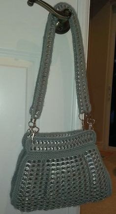 Purse made from soda tabs crocheted together.