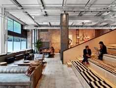 Multifunctional, auditorium-style steps in New York's co-working space Neuehouse, designed by Rockwell Group, are used for meetings, lectures, and concerts; photos Eric Laignel