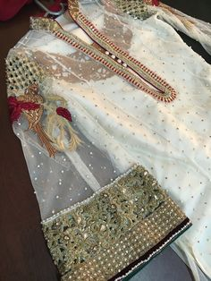 Asifa&Nabeel Beautiful flare sleeve, four beads in neck look good. The undershirt suit looks awesome Pakistani Wedding Outfits, Pakistani Dresses, Indian Dresses, Indian Outfits, Pakistani Couture, Pakistani Dress Design, Classy Suits, Kurti Designs Party Wear, Pakistan Fashion