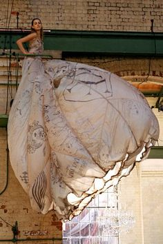"""Parachute-esque - An evening gown by Robert Cary-Williams covered in """"Alice in Wonderland"""" illustrations"""