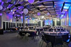 Beautiful lanterns with uplighting at the Metropolis Resort Skybox Banquet Room. Photo credit: Spin Vision. Eau Claire, WI