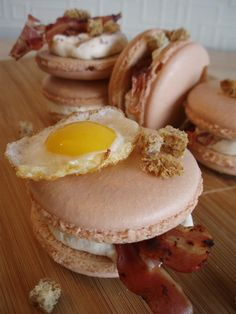 Breakfast-macaron : a savory macaron with bacon-cream, croutons and a fried quail's egg www.facebook.com/LilaLollipop