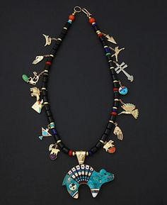 Necklace | Jesse Monongye (Navajo). Reversible bear pendant and necklace in 14K and 18K gold,opal turquoise, jet, sugilite, coral, lapis, gaspeite and shell