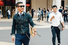 Nail that dapper look with a black denim jacket and navy dress pants.  Shop this look for $146:  http://lookastic.com/men/looks/denim-jacket-and-dress-shirt-and-tie-and-zip-pouch-and-dress-pants/3668  — Black Denim Jacket  — White Dress Shirt  — Navy Print Tie  — Tan Leather Zip Pouch  — Navy Dress Pants