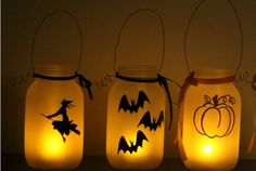 Cast a warm glow on your porch with these Halloween-themed lanterns.