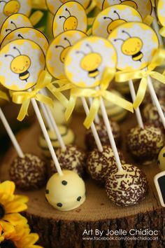 birthday themed bee / yellow grey white and black decoration for a baby girl first birtgday party / cake pops with labels