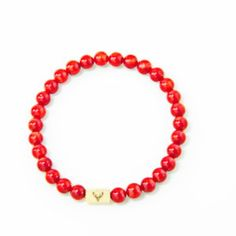 Accessories for the modern man who pays attention to details. Men's beaded bracelet with red coral beads & stainless steel charm.
