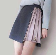 0507ca19f377b0 Medium shade grey mini with dull lemonade pink colour pleats in front.