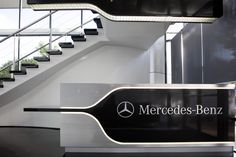 Mercedes-Benz needed to bring together two distinctly different parts of their business – financial services and Mercedes-Benz passenger / commercial vehicles. Flexible floor layouts that accommodate different needs deliver this cohesive feel. An extensive refurbishment provides reception, meeting rooms, staff café, vehicle showroom plus an open plan sales area. The aesthetic (including enviro