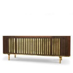 Retro and contemporary style were combined together to create Anthony mid-century modern living sideboard. Stunningly produced in solid walnut wood, it is topped by awhite polished marble and supported by brass square feet. It brings a playful geometric pattern on its doors, accented by its rounded edges and the brass trim all over the body.