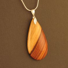 I want an inlaid wood pendant. Like real bad.