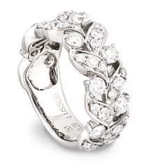 This diamond ring features a floral motif executed with round diamonds set in 18 karat white gold. This ring can be worn as a wedding band, right hand ring, or stacked with other bands - with either diamonds or colored gems - to create a look that is uniquely yours. Available in an array of sizes, the price reflects a stock size 4. This ring can be sized by a qualified jeweler, and contains a total of 1.29 carats of GH/VS quality diamonds.