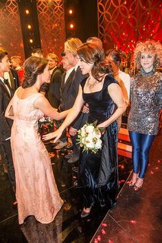 April 8 - Princess Marie and Crown Princess Mary of Denmark pass each other after having greeted the performing artists at a Galla Show held in honor of HRH Queen Margarethe of Denmarks 75 Year Birthday on April 16, 2015 in Aarhus.