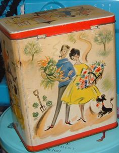 Vintage fifties tea caddy ids made by Twinings - graphics typical of fifties era  In good vintage condition with overall colours bright but a