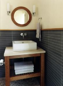 Idea for back powder room.  Tile easily cleaned compared to a painted drywall.