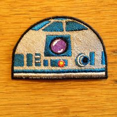 3X2.5in. Small but with lots of personality! Embroidered R2D2 you-sew patch goes with you anywhere. Star Wars fans, you want this! Put him on your