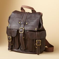 """WASHED LEATHER BACKPACK�--�Vegetable tanned leather, washed to vintage softness, shapes a handsome traveler. Under the buckled, magnetic flap, the drawstring top opens to a roomy, lined interior with zip and phone pockets. Outside, two buckled, magnetic pouch pockets keep things handy. Top carry handle, adjustable webbing shoulder straps. Imported. 13""""W x 6""""D x 15""""H."""