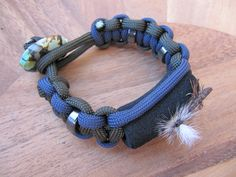 Woman's beaded paracord bracelet that also holds your flies.
