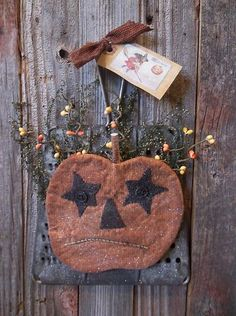 Primitive Handmade Halloween Jack-O-Lantern on Vintage Metal Kitchen Grater