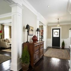 The look I want: tan walls, wainscot paneling in some accent areas to tie in with my white craftsman style cabinets, and rich dark wood floors.