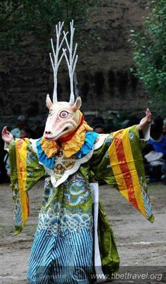 The monk in the deer's dressed performs religious dance called Cham in Tibetan society. Local people's really like to sit and catch the whole sessions of such dances. It happens once a year.