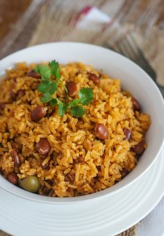 Rice with Beans (Moro de Habichuelas) ~ One of the most common dishes in the Dominican Republic, Moro is a mixture of rice, beans and vegetables. One of the most common dishes in the Dominican Republic, Moro is a mixture of rice, beans and vegetables. Spanish Rice And Beans, Rice With Beans, Mexican Beans And Rice, Dominican Rice And Beans Recipe, Dominican Recipes, Cuban Red Beans And Rice Recipe, Recipe For Spanish Rice, Comida Boricua, Gastronomia