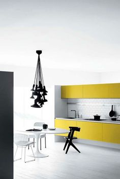 Due to the entire kitchen being black and white - the yellow cabinets clearly draw the eye and catch attention bring vibrance and color as well as happy energy into the home. Yellow Kitchen Designs, Kitchen Colors, Kitchen Decor, Kitchen Ideas, Kitchen Yellow, Kitchen Modern, Happy Kitchen, Pantry Ideas, Modern Kitchens