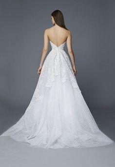 Stunning strapless v-shape back design with A-line waistline; Featured Dress: Antonio Riva