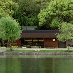 """Louver screens and """"engawa"""" style roof overhangs, as well as insulated exterior walls and window frames, are used to block the sun and reduce heating and cooling needs at this Starbucks store located at the center of Japan's serene Ohori Park."""