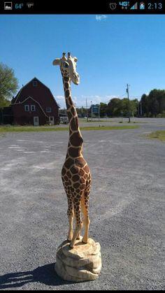 Chain saw carving of giraffe