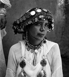 Black and white portrait of a Berber woman, adorned in
