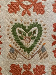 """Oak Leaf and Reel with Center Heart Block, circa 1876. """"This is likely a friendship quilt; the blocks appear to have been done by several different people with different skill levels and techniques. The heart symbol in the center is embellished with embroidery; some of the colors have changed (fugitive dyes). The flags were probably added due to the increase of patriotism around the Centennial."""" detail"""