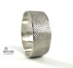 This Hammered textured 14k white gold wedding ring, was chiseled handmade by special hammering technique , which created a special glowing texture .  Designed for men and women.