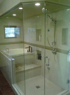 Stunning spa shower boasts white and gray marble tiles and ceiling ...