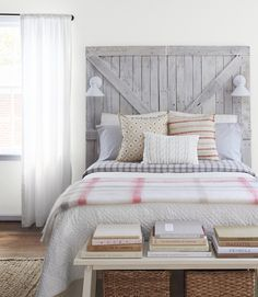"A statement-making barn door headboard adds buckets of country charm to a bedroom. This rustic find is made from reclaimed shipping pallets. $300 for a 70"" tall by 65"" wide headboard (fits a full or queen); dixon anddad.etsy.com - CountryLiving.com"
