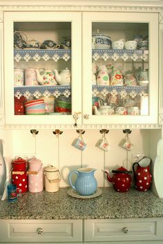 happy hutch  love the blue and white crochet trim and cup hooks