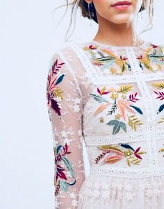 Pretty white delicately embroidered with colorful flowers. Very feminine, great for a bridal shower.